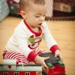 Stock Photo: Infant Mixed Race Baby Enjoying Christmas Morning Near The Tree