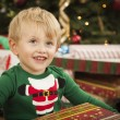 Young Boy Enjoying Christmas Morning Near The Tree — Foto Stock