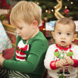 Mixed Race Baby and Young Boy Enjoying Christmas Morning Near Th — Foto Stock