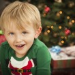 Young Boy Enjoying Christmas Morning Near The Tree — Foto de Stock