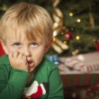 Young Grumpy Boy Sitting Near Christmas Tree — Photo