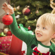 Young Boy Enjoying Christmas Morning Near The Tree — Stock fotografie