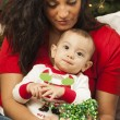 Ethnic Woman With Her Mixed Race Baby Christmas Portrait — Stock Photo #17126365