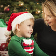 Stock Photo: Young Mother and Baby Son Christmas Portrait