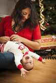Ethnic Woman With Her Mixed Race Baby Christmas Portrait — Stock Photo