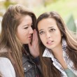 Mixed Race Woman Whispering Secrets Outside — Stock Photo