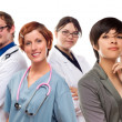 Young Mixed Race Woman with Doctors and Nurses Behind — Stock Photo #17867559
