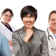 Young Mixed Race Woman with Doctors and Nurses Behind — Stock Photo