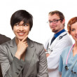 Mixed Race Women and Businessman with Doctors or Nurses — Stock Photo #17867591