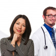 Hispanic Woman with Male and Female Doctors or Nurses — Stock Photo #17867727