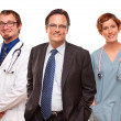Smiling Businessman with Doctors and Nurses — Stock Photo #17867799