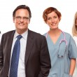 Royalty-Free Stock Photo: Smiling Businessman with Doctors and Nurses