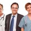 Group of Doctors or Nurses and Businessman on White - Stock Photo