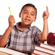 Hispanic Boy Raising His Hand, Books, Apple, Pencil and Paper - Stock Photo