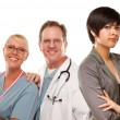 Young Mixed Race Woman with Doctors and Nurses Behind — Stock Photo #17868003