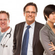 Mixed Race Women and Businessman with Doctors or Nurses — Stock Photo