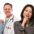 Hispanic Woman with Male and Female Doctors or Nurses — Stock Photo #17868151
