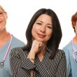 Hispanic Woman with Female Doctors and Nurses — Stock Photo