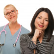 Hispanic Woman with Female Doctor or Nurse — Stock Photo