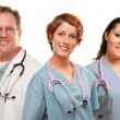 Group of Smiling Male and Female Doctors or Nurses — Stock Photo #17868203