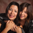 Attractive Hispanic Mother and Daughter Portrait — Stock Photo #17868251