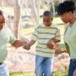 Beautiful African American Family Playing Outside — Stock Photo