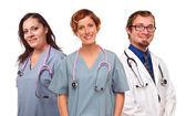 Grupa uśmiechnięty mężczyzna i kobieta lekarze lub pielęgniarki — Zdjęcie stockowe