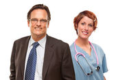 Smiling Businessman with Female and Doctor and Nurse — Stock Photo