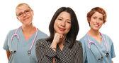 Hispanic Woman with Female Doctors and Nurses — Stock Photo