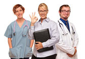 Businesswoman Making Okay Hand Sign with Doctors or Nurses — Stock Photo
