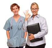 Businesswoman Making Okay Hand Sign with Doctor or Nurse — Stock Photo