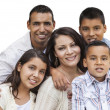 glad attraktiva spansktalande familjeporträtt på vit — Stockfoto