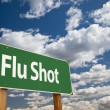 Flu Shot Green Road Sign - Stock Photo