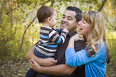 Happy Mixed Race Ethnic Family Playing In The Park — Stockfoto