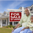 Father and Son In Front of For Sale By Owner Sign and House — Stock Photo