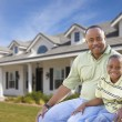 Playful Father and Son In Front of Home — Stock Photo #19379705