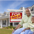 Father and Son In Front of Sold For Sale Sign and House — Stock Photo