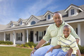 Playful Father and Son In Front of Home — Stock Photo