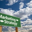 Marketing, Strategy Green Road Sign Over Clouds - Foto Stock