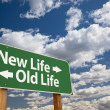 New Life, Old Life Green Road Sign Over Clouds — Stockfoto #19911357
