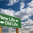 New Life, Old Life Green Road Sign Over Clouds — 图库照片