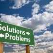 Solutions, Problems Green Road Sign Over Clouds — Zdjęcie stockowe