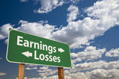 Earnings, Losses Green Road Sign Over Clouds — Stock Photo
