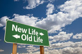 New Life, Old Life Green Road Sign Over Clouds — Stock Photo