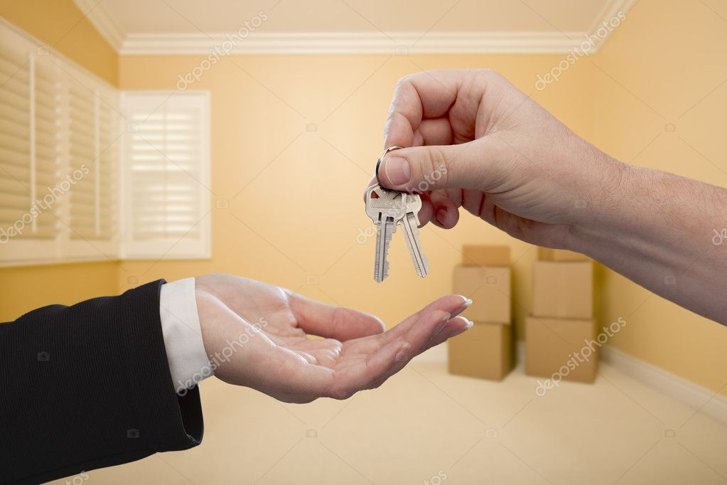 Handing Over the House Keys To A New Home Inside Empty Room. — Stock Photo #19972273