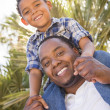 Mixed Race Father and Son Playing Piggyback — Stock Photo