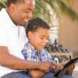 Mixed Race Father and Son Using Touch Pad Computer Tablet — Stock Photo