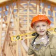 Stock Photo: Child Boy Dressed Up as Handymin Front of House Framing