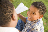 Mixed Race Father and Son Playing with Paper Airplanes — Stock Photo