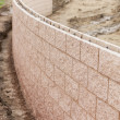 New Outdoor Retaining Wall Being Built - Stock Photo